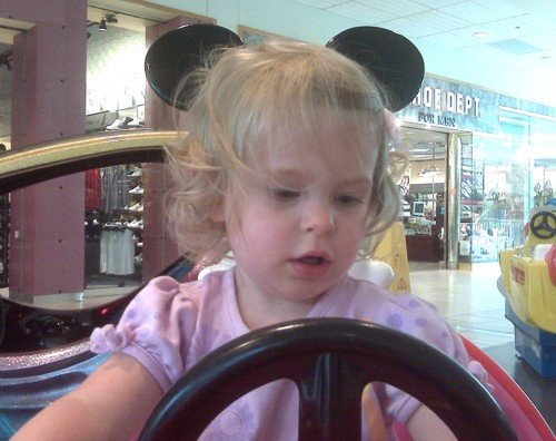 """Her first """"quarter horse"""", the Mickey Mouse car"""